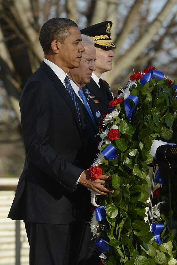 ARLINGTON, VA - JANUARY 20:  U.S. President Barack Obama, U.S. Vice President Joe Biden and Major General Michael S. Linnington, Commander of the US Army Military District of Washington participate in a wreath-laying ceremony at the Tomb of the Unknown Soldier January 20, 2013 in Arlington National Cemetery, Arlington, Virginia. Both Obama and Biden will be sworn in today for a second term in office. Photo: Pool, Getty Images
