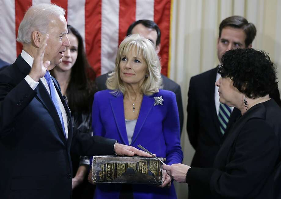 WASHINGTON - JANUARY 20:  U.S. Vice President Joe Biden (L) takes the oath of office from U.S. Supreme Court Justice Sonia Sotomayor (R) as his wife Dr. Jill Biden looks on during the official swearing-in ceremony at the Naval Observatory on January 20, 2013 in Washington, DC. Biden and U.S. President Barack Obama will be officially sworn in a day before the ceremonial inaugural swearing-in. Photo: Pool, Getty Images