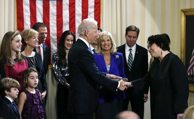WASHINGTON - JANUARY 20:  U.S. Vice President Joe Biden (4th R) shakes hands with U.S. Supreme Court Justice Sonia Sotomayor (R) after taking the oath of office as his wife Dr. Jill Biden (3rd R) looks on during the official swearing-in ceremony at the Naval Observatory on January 20, 2013 in Washington, DC. Biden and U.S. President Barack Obama will be officially sworn in a day before the ceremonial inaugural swearing-in. Photo: Pool, Getty Images
