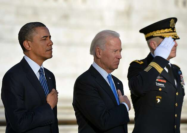 US President Barack Obama and Vice President Joe Biden lay a wreath at the Tomb of the Unknowns at Arlington National Cemetery in Arlington, Virginia, on January 20, 2013. Obama will be officially sworn in for a second term in office later in the day. Photo: Jewel Samad, AFP/Getty Images