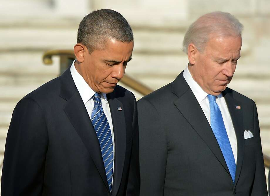 US President Barack Obama and Vice President Joe Biden arrive to lay a wreath at the Tomb of the Unknowns at Arlington National Cemetery in Arlington, Virginia, on January 20, 2013. Obama will be officially sworn in for a second term in office later in the day. Photo: Jewel Samad, AFP/Getty Images