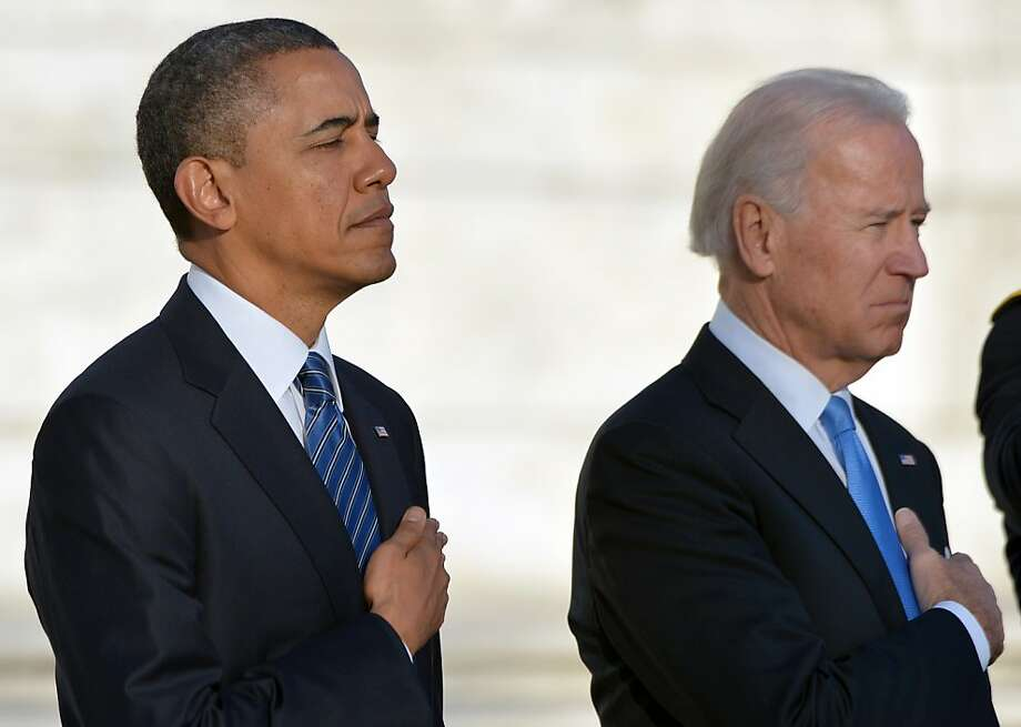 US President Barack Obama and Vice President Joe Biden lay a wreath at the Tomb of the Unknowns at Arlington National Cemetery in Arlington, Virginia, on January 20, 2013. Obama and Biden will be officially sworn in for a second term in office later in the day. Photo: Jewel Samad, AFP/Getty Images