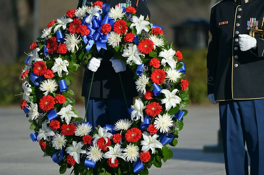 A soldier holds a wreath for US President Barack Obama and Vice President Joe Biden to lay at the Tomb of the Unknowns at Arlington National Cemetery in Arlington, Virginia, on January 20, 2013. Obama will be officially sworn in for a second term in office later in the day. Photo: Jewel Samad, AFP/Getty Images