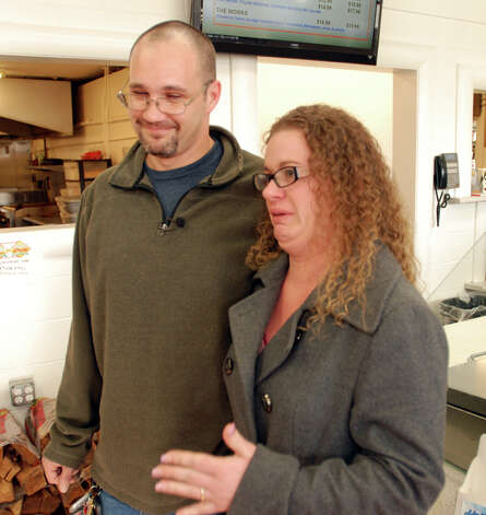 Misti Gunn fights back tears Tuesday at a market in Merlin, Ore., as she describes the financial hardship her family went through before winning $1 million in the Oregon Lottery. Rily Gunn said he was driving his family home to their cabin in the woods after registering for computer programming classes when he pulled off the freeway for corn dogs for the kids, and decided on a hunch to buy a lottery ticket, though he knew his wife would disapprove. Photo: AP