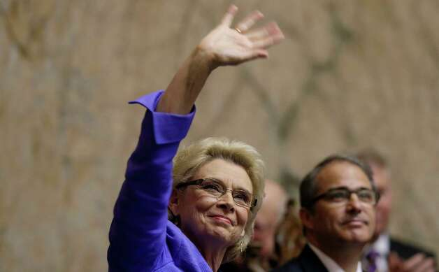 Washington Gov. Chris Gregoire waves to people seated in the gallery before giving her final State of the State speech to a joint session of the legislature, Tuesday at the Capitol in Olympia, Wash. Gregoire will leave office Wednesday, Jan. 16, after two terms as Governor, when fellow Democrat Jay Inslee is sworn in. Photo: AP
