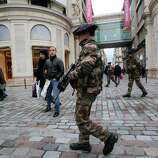 French army soldiers patrol along a main department store in Paris, Tuesday. Armed soldiers are on patrol in Paris' subways, train stations and some of the world's most recognizable monuments to head off terror attacks after France's military launched an operation to push back al-Qaida-linked insurgents in Mali.