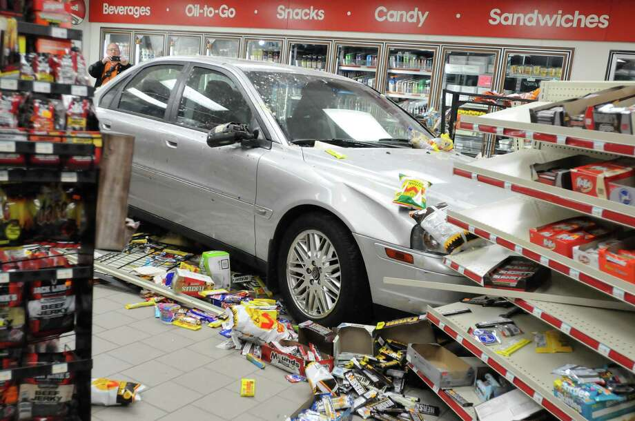 A vehicle sits inside Blouch's Mobile mini-mart after it crashed through a wall on Tuesday in Lebanon, Pa. (AP Photo/Lebanon Daily News, Jeremy Long) Photo: AP