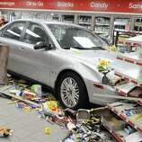 A vehicle sits inside Blouch's Mobile mini-mart after it crashed through a wall on Tuesday in Lebanon, Pa. (AP Photo/Lebanon Daily News, Jeremy Long)