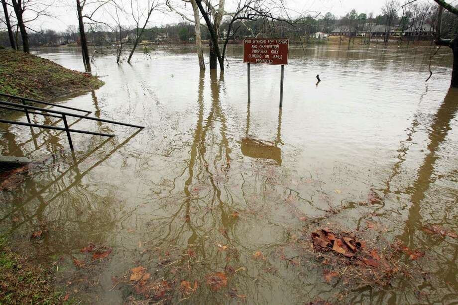 A pier at the Park at Manderson Landing is submerged by floodwaters from the Black Warrior River in Tuscaloosa, Ala., on Tuesday.  Since Sunday, about three inches of rain had fallen in the area, according to the National Weather Service in Birmingham, Ala. Photo: AP