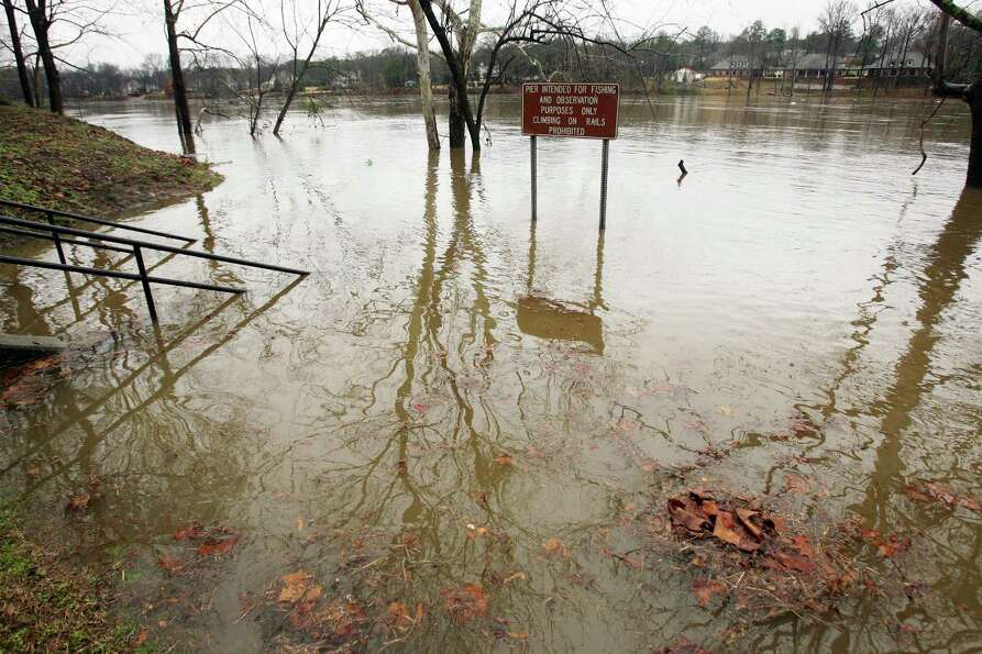 A pier at the Park at Manderson Landing is submerged by floodwaters from the Black Warrior River in