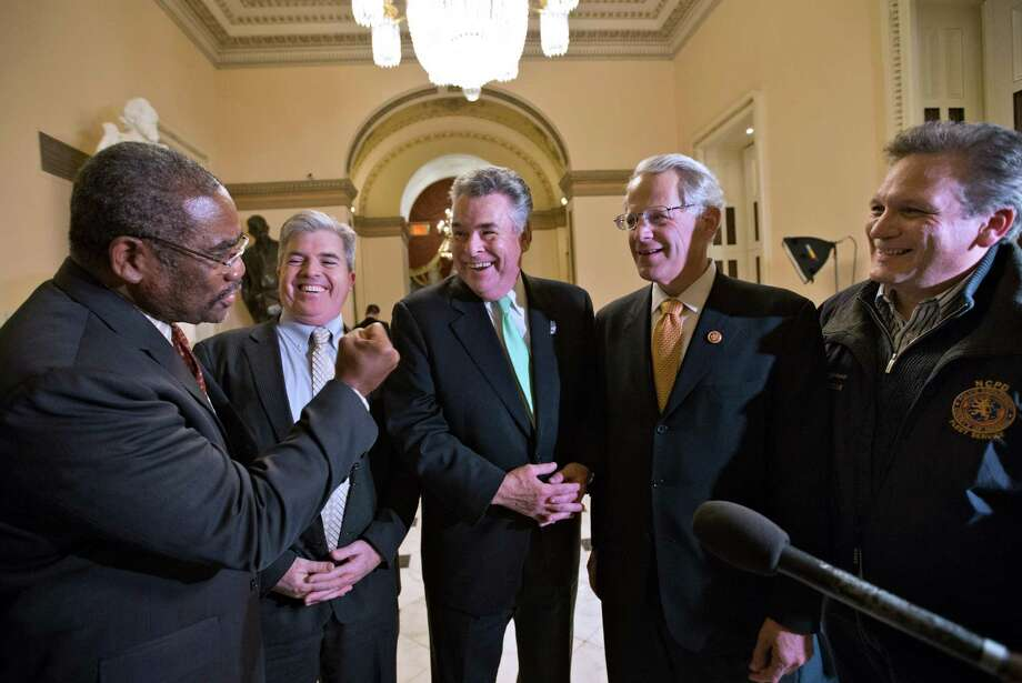 From left, Rep. Gregory W. Meeks, D-N.Y., Suffolk County, N.Y., Executive Steve Bellone, Rep. Peter King, R-N.Y., Rep. Steve Israel, D-NY, and Nassau County Executive Edward P. Mangano, celebrate just after the House of Representatives passed a $50.7 billion emergency aid bill for states hit by Superstorm Sandy on Tuesday at the Capitol in Washington. The measure is expected to pass the Senate as well. Photo: AP