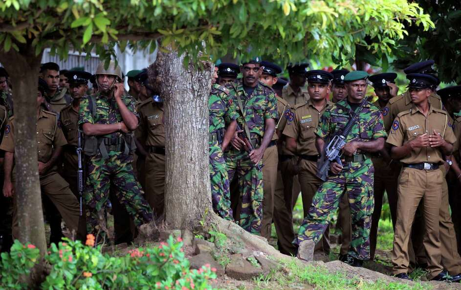 Sri Lankan security personnel stand guard outside the Supreme Court complex in Colombo, Sri Lanka, T