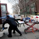 Police and emergency personnel transport a man to an ambulance after a shooting at Stephens Institute of Business and Arts on Washington Avenue in St. Louis on Tuesday.  A part-time student strode into the office of a longtime administrator at the school and shot the man in the chest, creating panic in the school before turning the gun on himself, police said.  (AP Photo/St. Louis Post-Dispatch, David Carson)