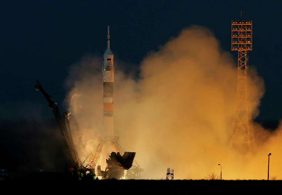 The Russian Space Agency says it will send a spacecraft to the moon in 2015 from a new launch pad in the country's Far East. Roscosmos head Vladimir Popovkin said on Tuesday, Jan. 15, 2013, the moon-bound spacecraft would be launched from Russia's new Vostochny cosmodrome. President Putin has vowed to invest $1 billion in building this launch pad in the Amur Region not far from the Chinese border. In this Dec. 19, 2012 file photo the Soyuz-FG rocket  booster with Soyuz TMA-07M space ship blasts off from the Russian leased  Baikonur cosmodrome, Kazakhstan. Photo: AP