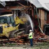 A bulldozer is used to demolish a two-story apartment building  in Dallas, Texas on Monday where Lee Harvey Oswald briefly lived before assassinating President John F. Kennedy. The rundown building was demolished by court order after a dispute between the city and landlord Jane Bryant.