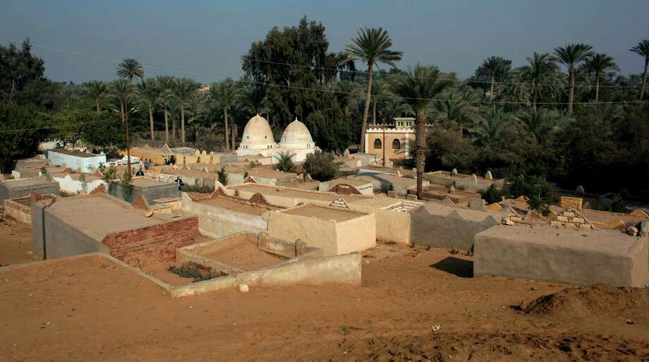 The illegal expansion of a local cemetery, shown here last week, has raised a panic among antiquities experts, who warn that the construction endangers the ancient, largely unexplored complex of Dahshour. The tombs are small complexes on their own, build mainly of cheap white bricks: Each is a walled courtyard with multiple enclosed niches where multiple family members can be buried. Rows of them now cover several acres inside the UNESCO-defined antiquities zone of Dahshour, coming to within 150 meters of Sneferu's Valley Temple. Photo: AP