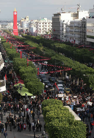 Tunisians demonstrate on Tunis's main avenue to mark the second anniversary of the Revolution on Monday. Two years after the revolution that overthrew an authoritarian president and started the Arab Spring, Tunisia is struggling with high unemployment and rising violence in its politics. Photo: AP
