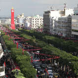 Tunisians demonstrate on Tunis's main avenue to mark the second anniversary of the Revolution on Monday. Two years after the revolution that overthrew an authoritarian president and started the Arab Spring, Tunisia is struggling with high unemployment and rising violence in its politics.