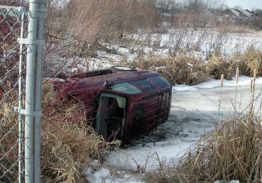 Authorities say Nancy Breberg, of Centerville, veered off the road Saturday, Jan. 13, crashed through a fence, landed on the pond and became trapped in her overturned car for 18 hours until a bicyclist found her Sunday. Breberg's husband said Monday she was expected to recover. Photo: AP