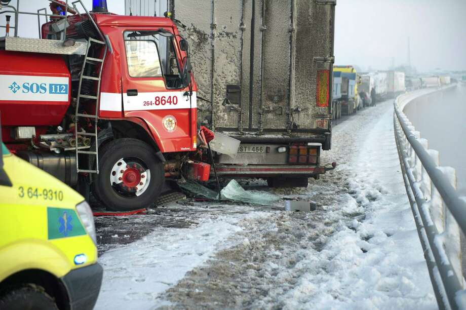 Traffic cues build up along the main E4 highway near Helsingborg, southwestern Sweden, as some 40 cars crashed into one another due to dense fog and slippery road conditions. Several people have been killed on the E4 motorway following the multi-vehicle accidents on Tuesday. (AP Photo/Bjorn Lindgren) Photo: AP