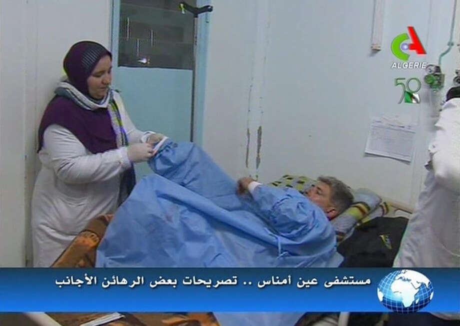 An unidentified rescued hostage receives treatment in a hospital in Ain Amenas, Algeria, in this image taken from television  Friday. Photo: AP