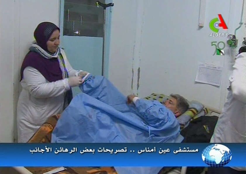 An unidentified rescued hostage receives treatment in a hospital in Ain Amenas, Algeria, in this ima