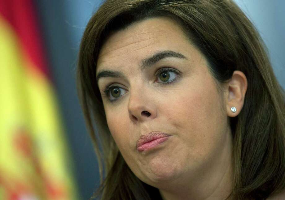 Spain's government spokeswoman and deputy premier Soraya Saenz de Santamaria speaks during a news conference at the Moncloa Palace in Madrid, Friday. Spain's conservative government is battling to defend itself and its Popular Party after a court revealed a former party treasurer amassed $29.31 million in a Swiss bank account.  Saenz de Santamaria fended off a barrage of questions from journalists Friday by denying she knew anything about the money or newspaper reports that ex-treasurer Luis Barcenas also gave party members large sums in under-the table payments. She skirted questions as to whether Prime Minister Mariano Rajoy or other government members may have received money. Photo: AP