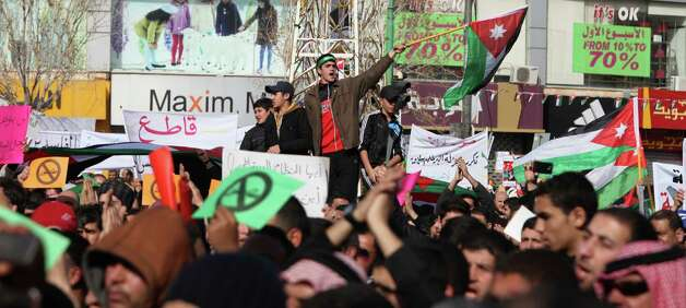 Demonstraters wave the Jordanian flag during a protest by the Muslim Brotherhood movement and other opposition parties against the upcoming parliamentary elections, in Amman, Jordan, Friday. Friday's peaceful demonstration drew about 1,300 Muslim Brotherhood members and others, united in the election boycott and in demands that King Abdullah II cede some of his powers and give parliament more say in the country. The demonstration comes just five days before elections that will for the first time see a prime minister emerge from among the winning candidates, rather than by appointment by the king. Photo: AP