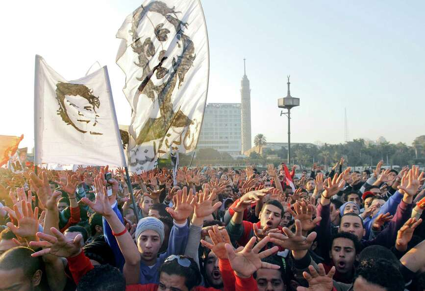 Thousands of soccer fans of Egypt's most popular team, Al-Ahly, march towards Tahrir Square, the foc