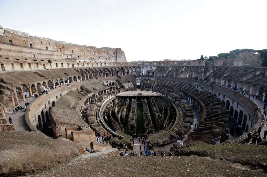 Tourists vitis Rome's Colosseum on Friday. Photo: Gregorio Borgia, AP / AP2013