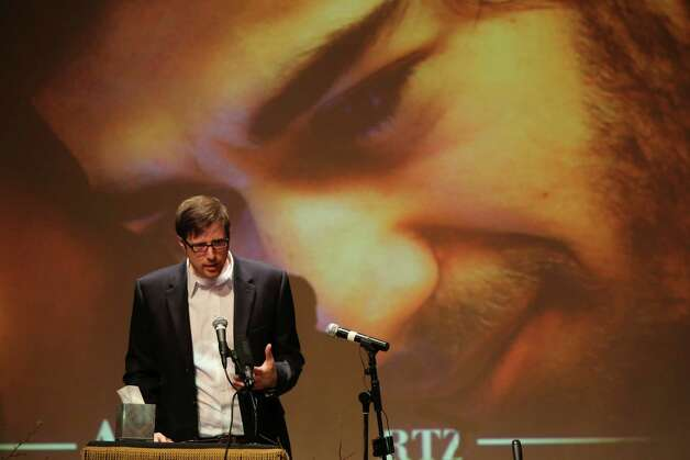 Ben Winkler, a long time friend, speaks during the memorial service for Aaron Swartz, Saturday in New York. Friends and supporters of Swartz paid tribute Saturday to the free-information activist and online prodigy, who killed himself last week as he faced trial on hacking charges. Photo: AP