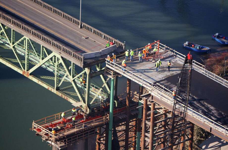 The Sellwood Bridge,  the 87-year-old southeast Portland span is moved a few yards to aid the construction of its replacement on Saturday in Portland, Ore. (AP Photo/The Oregonian, Randy L. Rasmussen) Photo: AP