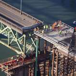 The Sellwood Bridge,  the 87-year-old southeast Portland span is moved a few yards to aid the construction of its replacement on Saturday in Portland, Ore. (AP Photo/The Oregonian, Randy L. Rasmussen)