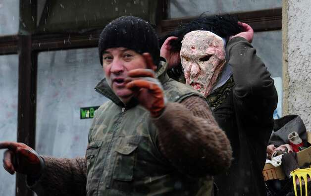 Villagers prepare masks of cannibals, made from natural materials on Saturday, a day before the carnival in Macedonia's southwestern village of Vevcani.  The masks are a tightly kept secret until the day when hundreds of villagers parade on the streets. Said to date from pagan times 1,400 years ago, the Vevcani carnival, with its colorful floats and masked revelers, has grown in popularity over the last decade and attracts thousands of visitors for the celebrations on St. Vasilij Day to welcome in the New Year, according to the Julian calendar. Photo: AP
