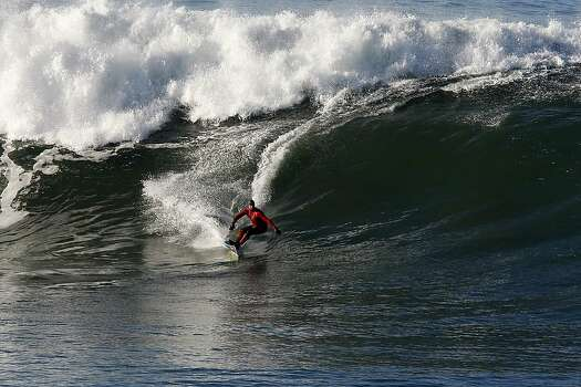 Chris Bertish goes left on a wave at Mavericks Surf Competition in Heat 2 on January 20, 2013 in Half Moon Bay, Calif.on January 20, 2013 in Half Moon Bay, Calif. Photo: Sean Havey, The Chronicle