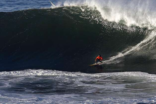 Tyler Fox catches a wave at Mavericks Surf Competition in the first heat of the day on January 20, 2013 in Half Moon Bay, Calif. Photo: Sean Havey, The Chronicle