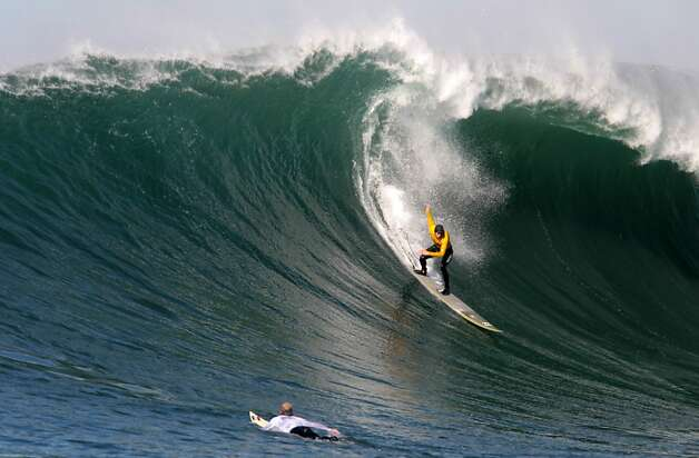 Colin Dwyer drops in on a wave during the first round of the Mavericks Invitational on Sunday, January 20, 2013. Photo: Mathew Sumner, Special To The Chronicle