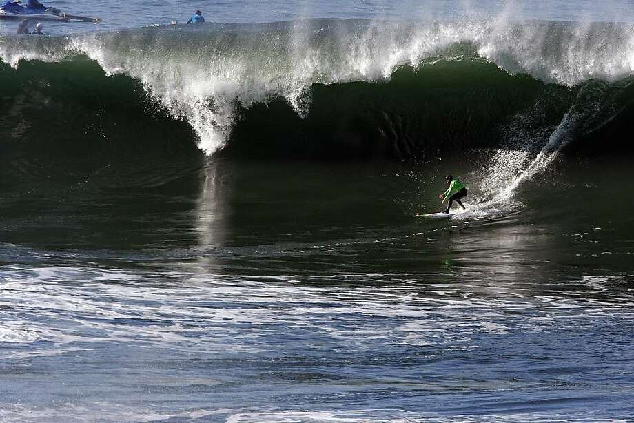 Zach Wormhoudt drops in on a wave at Mavericks Surf Competition in Heat 3 on January 20, 2013 in Half Moon Bay, Calif. Photo: Sean Havey, The Chronicle