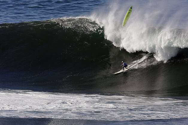 Ryan Augenstein drops in on a wave as Josh Loya wipes out at Mavericks Surf Competition in Heat 3 on January 20, 2013 in Half Moon Bay, Calif. Photo: Sean Havey, The Chronicle