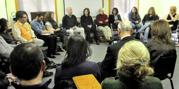Dr. James Gordon, left center, speaks during a workshop in resiliency and self-care for area psychologists and councilors dealing with the issues surrounding the shootings at Sandy Hook Elementary School. Photographed in Danbury on Sunday, Jan. 20, 2012. Photo: Michael Duffy