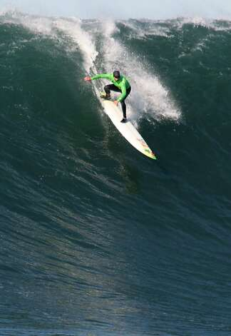 Grant Baker drops into a wave during the first round of the Mavericks Invitational on Sunday, January 20, 2013. Photo: Mathew Sumner, Special To The Chronicle