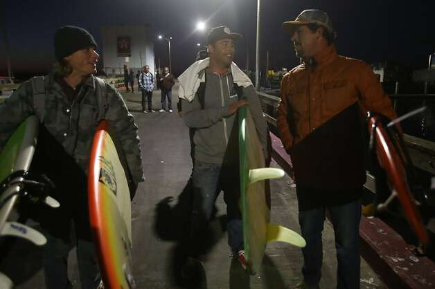 Mavericks Invitational contestants Mark Healey, left, Anthony Tashnick, center, and Peter Mel head out at Pillar Point Harbor on Sunday, January 19, 2013. Photo: Mathew Sumner, Special To The Chronicle