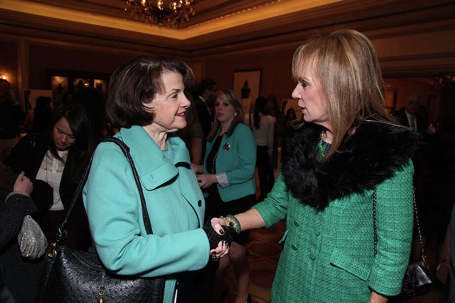 US Senator Dianne Feinstein (CA) is greeted by Norine Fuller, Luncheon Chair  as the California State Society and FIDM/Fashion Institute of Design & Merchandising present a Presidential Inaugural Luncheon and Fashion Show at the Ritz Cartlon Hotel in Washington, DC on Saturday, January 19, 2013. Photo: Alex J. Berliner, AP / ABImages
