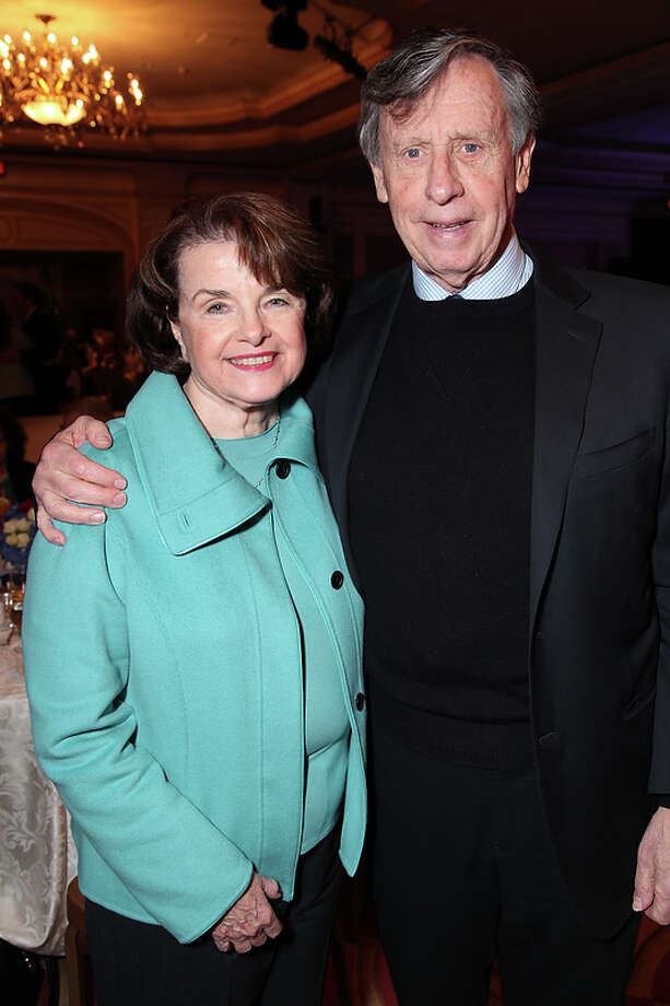 US Senator Dianne Feinstein (CA) and husband Richard Blum attend as the California State Society and FIDM/Fashion Institute of Design & Merchandising present a Presidential Inaugural Luncheon and Fashion Show at the Ritz Cartlon Hotel in Washington, DC on Saturday, January 19, 2013. Photo: Alex J. Berliner, AP / BERLA