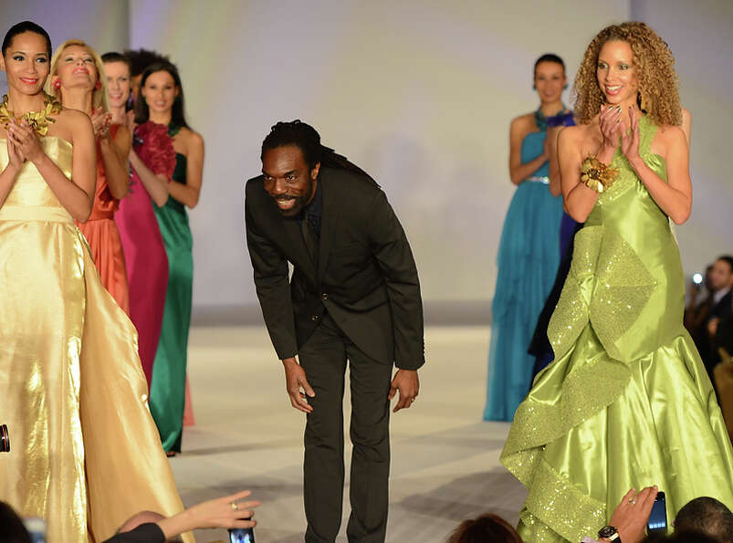 Fashion Designer Kevan Hall takes a bow as the California State Society and FIDM/Fashion Institute o