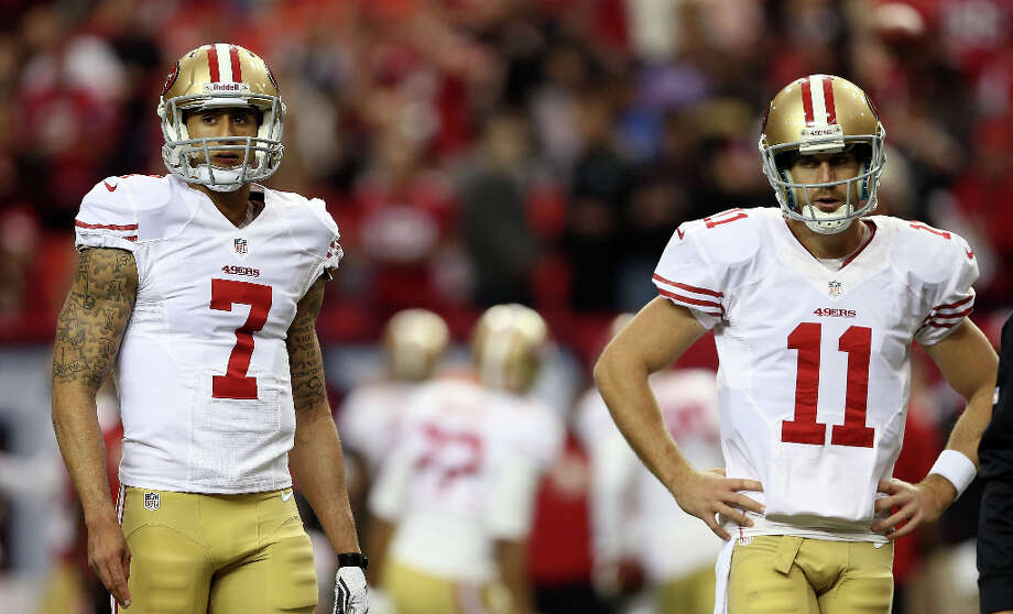 49ers quarterbacks Colin Kaepernick and Alex Smith warm up before taking on the Atlanta Falcons. Photo: Streeter Lecka / 2013 Getty Images