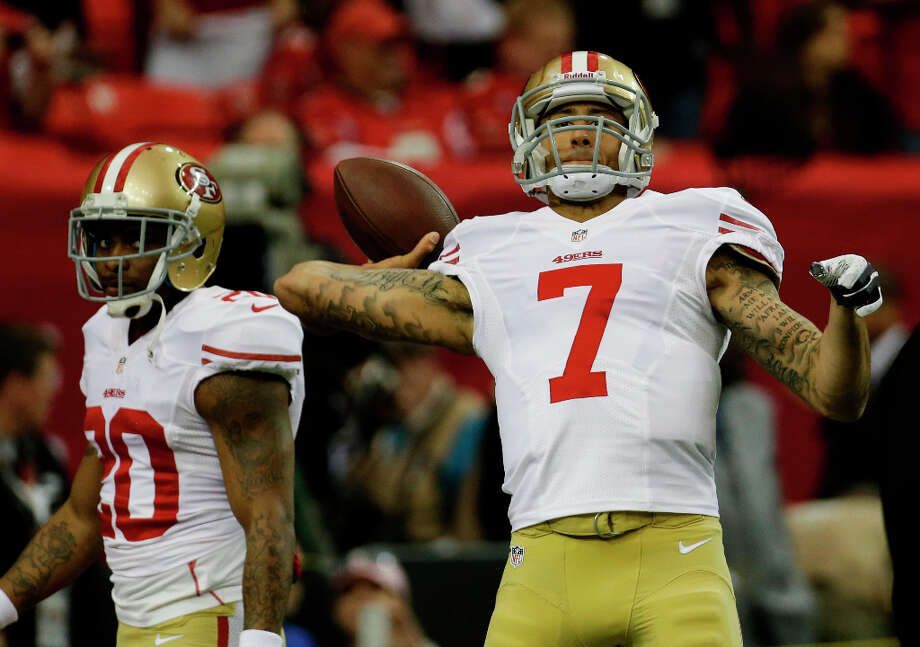 49ers quarterback Colin Kaepernick practices throws before the game starts. Photo: Dave Martin