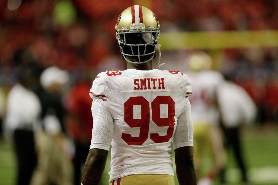Aldon Smith of the 49ers wears his helmet backwards before the start of the game. Photo: John Bazemore