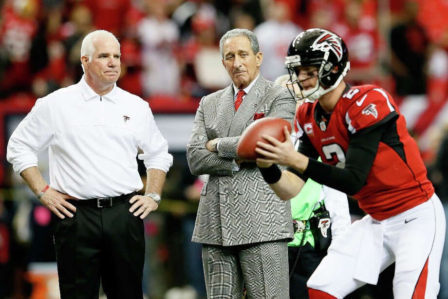 Atlanta Falcons head coach Mike Smith and owner Arthur Blank watch quarterback Matt Ryan warm up. Photo: Kevin C. Cox / 2013 Getty Images