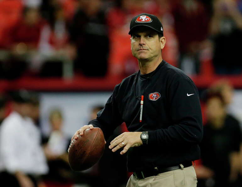 49ers coach Jim Harbaugh gets in touch with his roots as a quarterback before his team faces the Atl